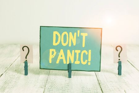 Text sign showing Don T Panic. Business photo text suddenly feel so worried or frightened that you can not behave Scribbled and crumbling sheet with paper clips placed on the wooden table