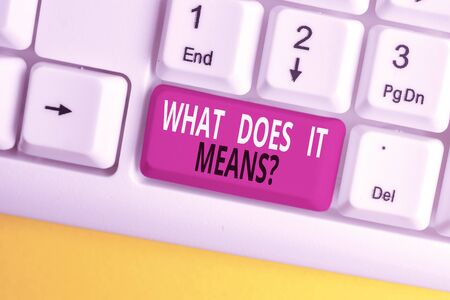 Text sign showing What Does It Means question. Business photo text asking someone about meaning something said and you do not understand White pc keyboard with empty note paper above white background key copy space