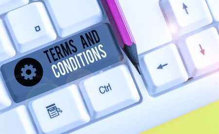 Text sign showing Terms And Conditions. Business photo showcasing rules that apply to fulfilling a particular contract White pc keyboard with empty note paper above white background key copy space