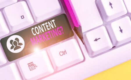 Conceptual hand writing showing Content Marketing question. Concept meaning involves creation and sharing of online material White pc keyboard with note paper above the white background Imagens