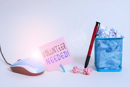 Handwriting text writing Volunteer Needed. Conceptual photo asking demonstrating to work for organization without being paid Plain note paper and stationary placed above soft pastel colour backdrop
