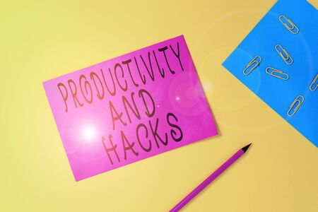 Writing note showing Productivity Hacks. Business concept for tricks that you get more done in the same amount of time Blank paper sheets message pencil clips binder plain colored background