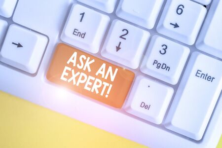 Text sign showing Ask An Expert. Business photo text confirmation that have read understand and agree with guidelines White pc keyboard with empty note paper above white background key copy space