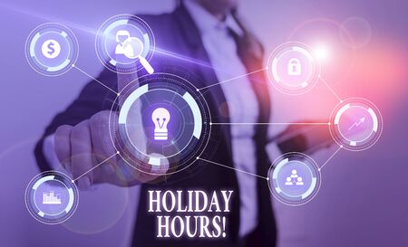 Text sign showing Holiday Hours. Business photo text Overtime work on for employees under flexible work schedules Woman wear formal work suit presenting presentation using smart device