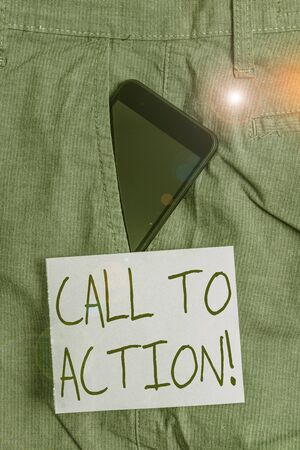 Word writing text Call To Action. Business photo showcasing exhortation do something in order achieve aim with problem Smartphone device inside formal work trousers front pocket near note paper