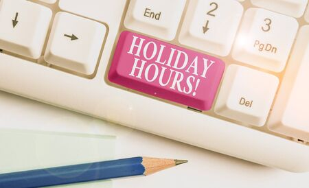 Text sign showing Holiday Hours. Business photo text Overtime work on for employees under flexible work schedules White pc keyboard with empty note paper above white background key copy space