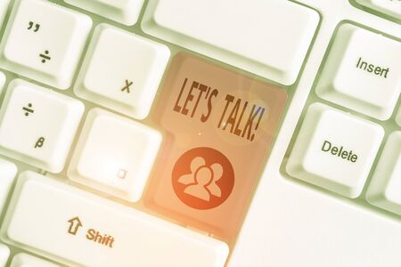 Writing note showing Let S Talk. Business concept for they are suggesting beginning conversation on specific topic White pc keyboard with note paper above the white background