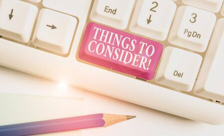 Text sign showing Things To Consider. Business photo text think about something carefully in order to make decision White pc keyboard with empty note paper above white background key copy space