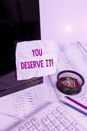 Text sign showing You Deserve It. Business photo showcasing should have it because of their qualities or actions Note paper taped to black computer screen near keyboard and stationary