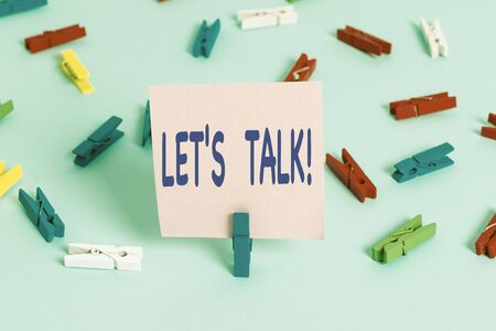 Text sign showing Let S Talk. Business photo showcasing they are suggesting beginning conversation on specific topic Colored clothespin papers empty reminder blue floor background office pin