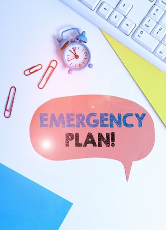 Text sign showing Emergency Plan. Business photo text actions developed to mitigate damage of potential events Flat lay above table with copy space on the bubble paper with clock and paper clips