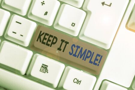 Conceptual hand writing showing Keep It Simple. Concept meaning ask something easy understand not go into too much detail White pc keyboard with note paper above the white background Stock Photo