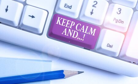 Text sign showing Keep Calm And. Business photo text motivational poster produced by British government White pc keyboard with empty note paper above white background key copy space