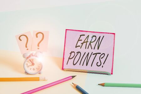 Conceptual hand writing showing Earn Points. Concept meaning collecting scores in order qualify to win big prize Mini size alarm clock beside stationary on pastel backdrop Stock fotó