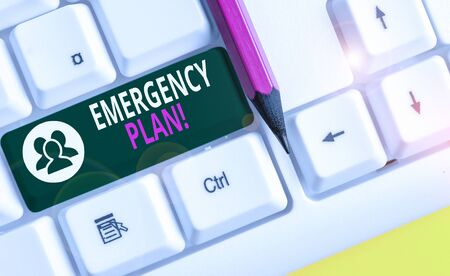 Conceptual hand writing showing Emergency Plan. Concept meaning actions developed to mitigate damage of potential events White pc keyboard with note paper above the white background
