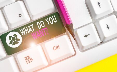 Conceptual hand writing showing What Do You Want Question. Concept meaning say or write in order to ask demonstrating about something White pc keyboard with note paper above the white background