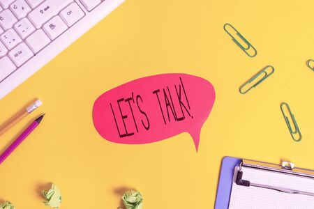 Conceptual hand writing showing Let S Talk. Concept meaning they are suggesting beginning conversation on specific topic Flat lay above empty paper with copy space and colored paper clips