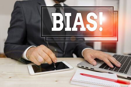 Text sign showing Bias. Business photo text inclination or prejudice for or against one demonstrating group Male human wear formal clothes present presentation use hi tech smartphone