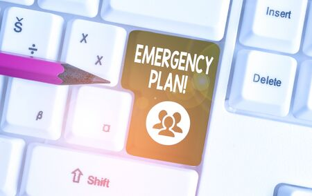 Handwriting text writing Emergency Plan. Conceptual photo actions developed to mitigate damage of potential events White pc keyboard with empty note paper above white background key copy space
