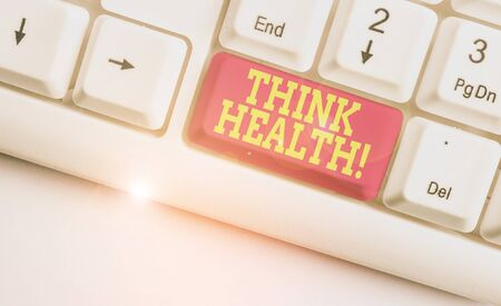Text sign showing Think Health. Business photo text state of complete physical mental and social well being White pc keyboard with empty note paper above white background key copy space