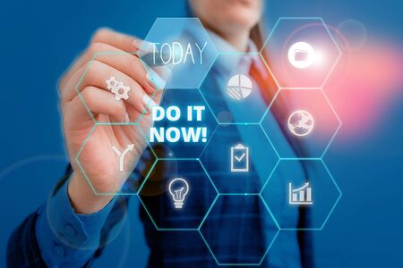 Text sign showing Do It Now. Business photo showcasing not hesitate and start working or doing stuff right away Woman wear formal work suit present presentation using smart latest device