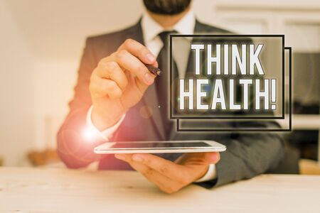 Conceptual hand writing showing Think Health. Concept meaning state of complete physical mental and social well being Male human wear formal clothes present use hitech smartphone