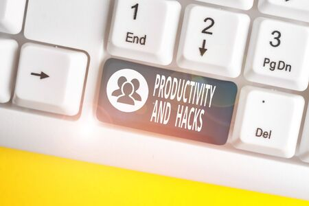 Text sign showing Productivity Hacks. Business photo showcasing tricks that you get more done in the same amount of time White pc keyboard with empty note paper above white background key copy space 写真素材