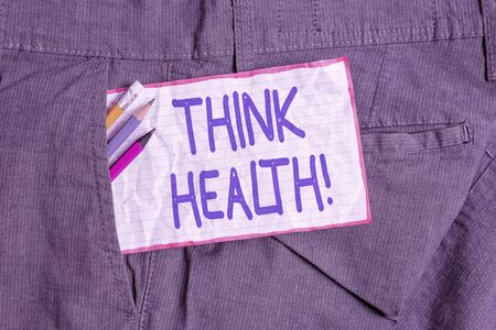 Text sign showing Think Health. Business photo text state of complete physical mental and social well being Writing equipment and white note paper inside pocket of man work trousers