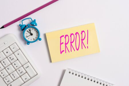 Text sign showing Error. Business photo text state or condition of being wrong in conduct judgement or program White pc keyboard with empty note paper and pencil above white background