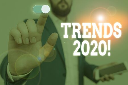 Handwriting text writing Trends 2020. Conceptual photo general direction in which something is developing or changing Male human wear formal work suit presenting presentation using smart device