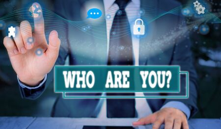 Text sign showing Who Are You Question. Business photo showcasing asking about someone identity or demonstratingal information Picture photo system network scheme modern technology smart device Banque d'images