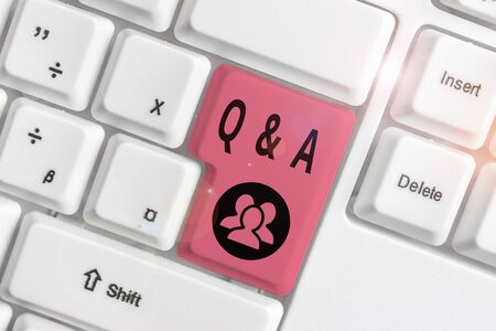 Writing note showing Q And A. Business concept for defined as questions being asked and answers White pc keyboard with note paper above the white background