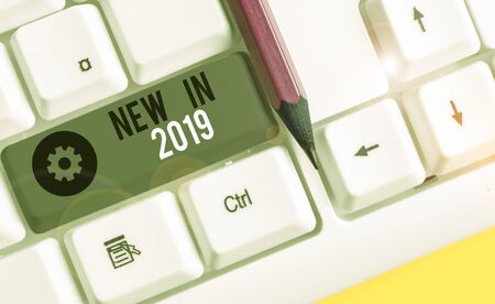 Text sign showing New In 2019. Business photo showcasing what will be expecting or new creation for the year 2019 White pc keyboard with empty note paper above white background key copy space