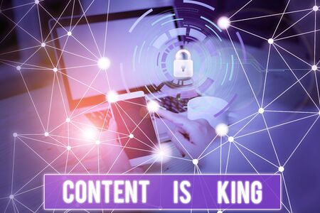 Conceptual hand writing showing Content Is King. Concept meaning marketing focused growing visibility non paid search results Picture photo network scheme with modern smart device Stock Photo