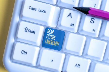 Handwriting text Dear Future I Am Ready. Conceptual photo suitable state for action or situation being fully prepared White pc keyboard with empty note paper above white background key copy space Reklamní fotografie