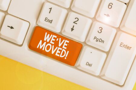 Text sign showing We Ve Moved. Business photo text having strong feelings sadness or sympathy has said or done White pc keyboard with empty note paper above white background key copy space