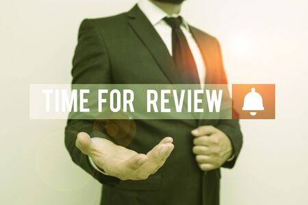 Word writing text Time For Review. Business photo showcasing review of a system or situation in its formal examination Male human with beard wear formal working suit clothes raising one hand up