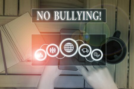 Writing note showing No Bullying. Business concept for stop aggressive behavior among children power imbalance Picture photo network scheme with modern smart device Stock fotó