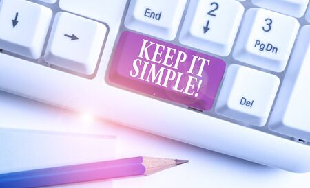 Text sign showing Keep It Simple. Business photo text ask something easy understand not go into too much detail White pc keyboard with empty note paper above white background key copy space