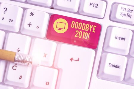 Conceptual hand writing showing Good Bye 2019. Concept meaning express good wishes when parting or at the end of last year White pc keyboard with note paper above the white background