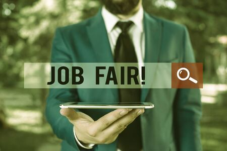 Handwriting text writing Job Fair. Conceptual photo event in which employers recruiters give information to employees Businessman in blue suite with a tie holds lap top in hands