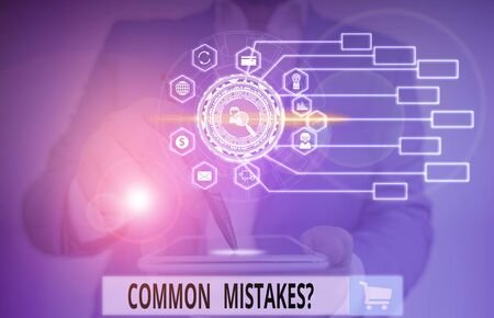 Writing note showing Common Mistakes question. Business concept for repeat act or judgement misguided or wrong Picture photo network scheme with modern smart device