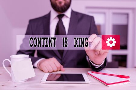 Handwriting text Content Is King. Conceptual photo marketing focused growing visibility non paid search results Male human wear formal clothes present presentation use hi tech smartphone