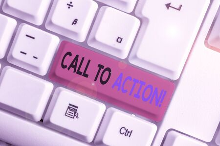 Conceptual hand writing showing Call To Action. Concept meaning exhortation do something in order achieve aim with problem White pc keyboard with note paper above the white background Imagens