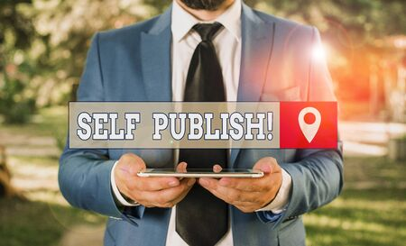 Writing note showing Self Publish. Business concept for writer publish piece of ones work independently at own expense Businessman in blue suite with a tie holds lap top in hands