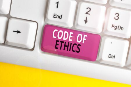 Text sign showing Code Of Ethics. Business photo text basic guide for professional conduct and imposes duties White pc keyboard with empty note paper above white background key copy space