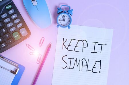 Handwriting text Keep It Simple. Conceptual photo ask something easy understand not go into too much detail Calculator clips clock clipboard mouse sheet pencil colored background