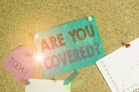 Conceptual hand writing showing Are You Covered Question. Concept meaning asking showing if they had insurance in work or life Corkboard size paper thumbtack sheet billboard notice board Standard-Bild