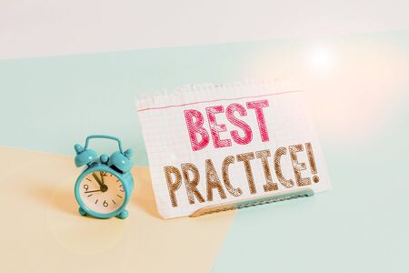 Word writing text Best Practice. Business photo showcasing commercial procedures accepted prescribed being correct Mini size alarm clock beside a Paper sheet placed tilted on pastel backdrop