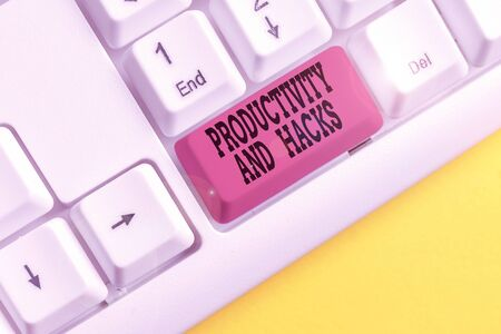 Conceptual hand writing showing Productivity Hacks. Concept meaning tricks that you get more done in the same amount of time White pc keyboard with note paper above the white background 写真素材